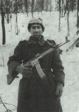 A sergeant from the 18th Infantry Division armed with a German Sturmgewehr 44
