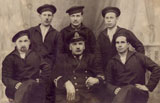 Crew members of the submarine Delfinul. Ion Agiu is in the center of the group, behind the captain.
