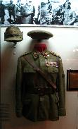 Uniform that belonged to general Leonard Mociulschi on display in the National Military Museum. In the top right corner there is a photo of the general on the front.