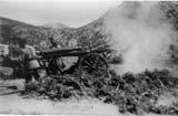 Firing a mountain gun.